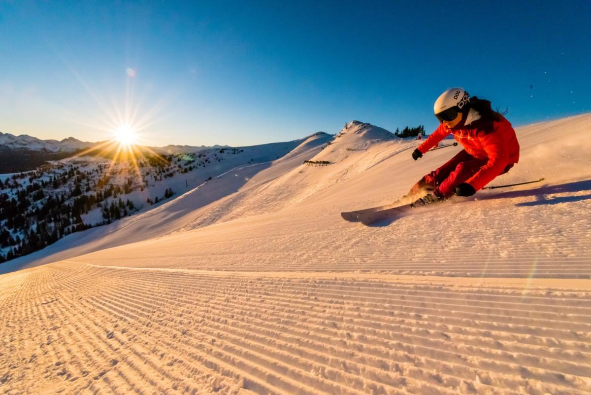 Je eerste afdalingen maak je terwijl de zon langzaam achter de bergen omhoog komt. Foto: Dorfgasteiner Bergbahnen